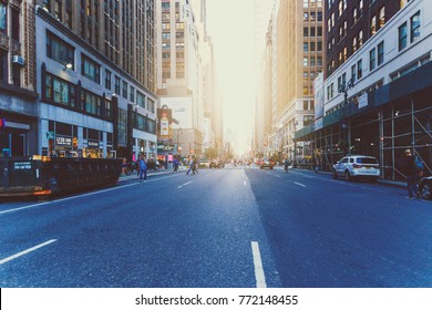 NEW YORK, USA - September 7th, 2017: sunflare among the streets in Midtown Manhattan at dusk