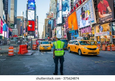 NEW YORK, USA - SEPTEMBER 8, 2015: Policeman stands on the Times Square during the road works, directs the traffic