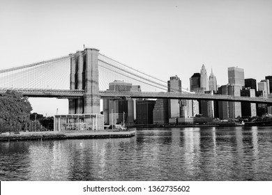 New York, USA. View of Manhattan bridge and Manhattan in New York, USA in the morning. Clear sky with skyscrapers. Black and white