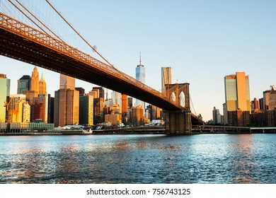 New York, USA. View of Manhattan bridge and Manhattan in New York, USA in the morning. Clear blue sky with skyscrapers