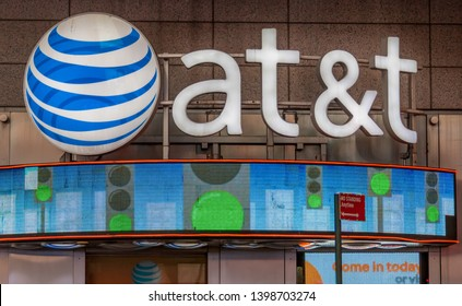New York, USA-April 22, 2019:  AT&T signage and logo outside one of its offices.  AT&T Inc. is an American multinational telecommunications corporation, headquartered  in downtown Dallas, Texas.