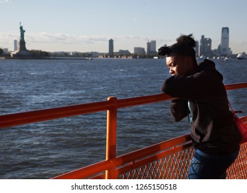 NEW YORK, USA-JUNE 8, 2017: Many tourists take the ferry from New York to New Jersey to take pictures The statue of Liberty and the skyline of downtown of Manhattan, USA, on June 8, 2017