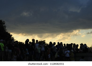 New York; USA-May 02;  2014- Unidentified  silhouette people, Weather, Climate, Rain, Tourist enjoying cool climate against clouds near Abraham Lincoln Statue at Lincoln Memorial in Washing DC
