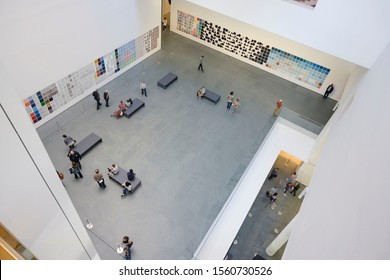 New York, USA-May 18 2019- Top view of People walking around in the visitor hall room at MoMA museum of modern art New York.