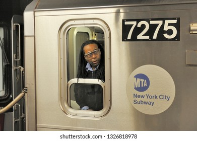 NEW YORK, USA-NOVEMBER 11, 2012: A subway driver in New York City looks back to check on riders.