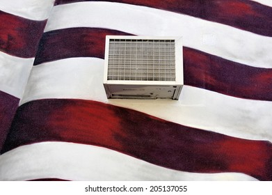NEW YORK, USA-NOVEMBER 11: Air-condition unit mounted outside against a wall that is painted with the American flag, November 11, 2012 New York City, USA