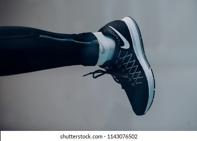 New york, Usa-September 13, 2017: Usa brand NIKE Sport shoe on leg. Running shoe with sock on sole. Trainer or sneaker. Sport footwear and fashion for active lifestyle. just do it. nike style