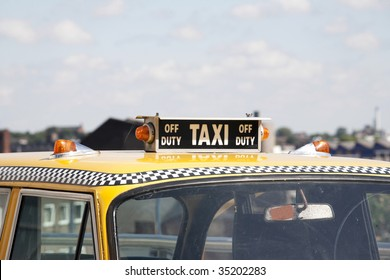 New York yellow taxi with roof sign