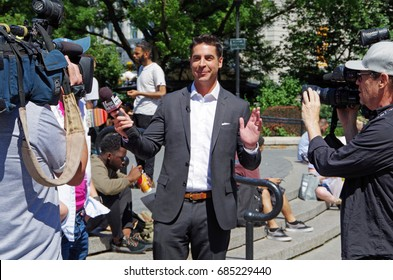 New York, New York-July Twenty Sixth, 2017: Jesse Watters from Fox News conducting interviews in Union Square Park, NYC.