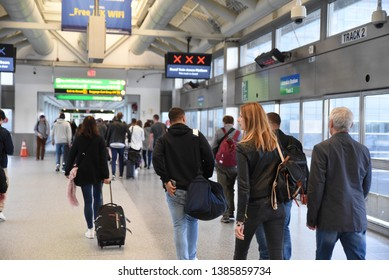 New York, New York/United States- 04/25/2019: A group of travelers from JFK International airport arrive at the Jamaica Station via AirTrain.