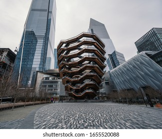 New York, New York/USA - February 5th 2020: Hudson Yards - Low angle view of skyscrapers and the Vessel on a cloudy day