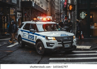 New York, New York/USA - February 6th 2020: Modern police car with red lights in New York