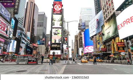 New York, New York/USA - May 5, 2018: The bright lights and electronic signs in Downtown Manhattan in Times Square. The epicenter of the business and tourism  world in America.