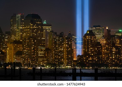 "NEW YORK, NEW YORK/USA - SEPTEMBER 5th, 2014: Buildings of New York city with the detail of ""Tribute in light"" rehearsal at Lower Manhattan."