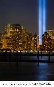 """NEW YORK, NEW YORK/USA - SEPTEMBER 5th, 2014: Buildings of New York city with the detail of """"Tribute in light"""" rehearsal at Lower Manhattan."""