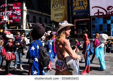 New York, New York/USA-10/01/2017: The  street artist Naked Cowboy seen in Times Square in New York City.