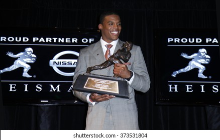 NEW YORK-DEC 11: Cam Newton, quarterback of the Auburn University Tigers, poses with the 2010 Heisman Memorial Trophy Award on December 11, 2010 in New York City.