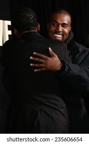 "NEW YORK-DEC 3: Comedian/actor Chris Rock (L) hugs Kanye West at the ""Top Five"" premiere at the Ziegfeld Theatre on December 3, 2014 in New York City."
