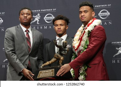 NEW YORK-DEC 8: (L-R) Ohio State Buckeyes quarterback Dwayne Haskins, Oklahoma Sooners quarterback Kyler Murray and Alabama Crimson Tide quarterback Tua Tagovailoa with the Heisman trophy in New York.