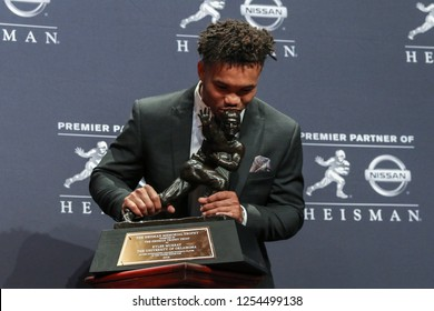 NEW YORK-DEC 8: Oklahoma Sooners quarterback Kyler Murray, winner of the 84th Heisman Trophy, kisses the trophy on December 8, 2018 at the Marriott Marquis in New York City.