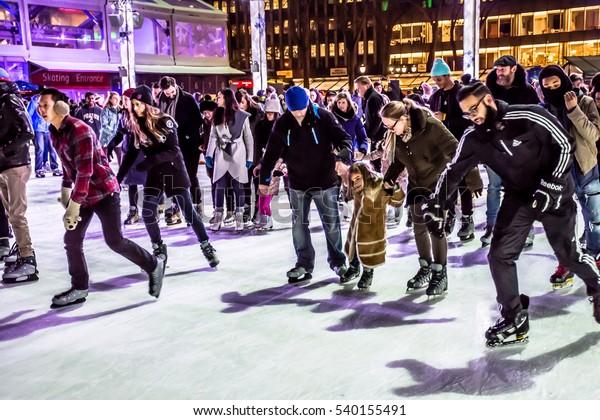 NEW YORK-DECEMBER 14: Ice skaters enjoy rink by the Bryant Park Christmas tree on December 14, 2016 in Manhattan.
