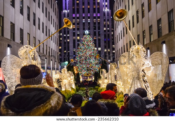 NEW YORK-DECEMBER 4: Crowds of tourists visit Rockefeller Center to see the tree and holiday decorations on December 4, 2014 in Manhattan.