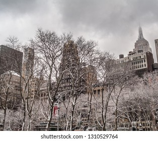 NEW YORK-FEBRUARY 28: An overcast low clouds view with the Empire State Building towering over Bryant Park on February 28 2005 in New York City.