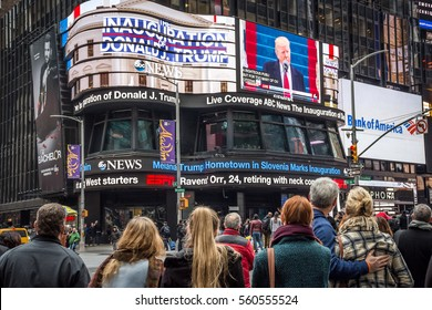 NEW YORK-JANUARY 20 - People watch the Donald J.Trump inauguration as the 45th President of the United States in Times Square on January 20 2017 in New York City.
