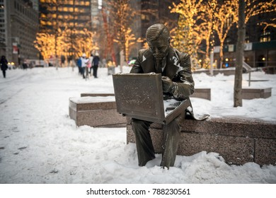NEW YORK-JANUARY 4: The businessman statue with fresh snow after the bomb cyclone snow storm in Zuccotti Park on January 4 2018 in lower Manhattan.