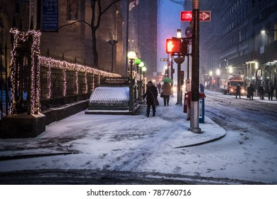 NEW YORK-JANUARY 4: Pedestrians at the break of dawn on Wall St during the bomb cyclone snow storm on January 4 2018 in lower Manhattan.