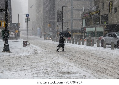 NEW YORK-JANUARY 4: A snow filled street scene during the bomb cyclone on January 4 2018 in lower Manhattan.