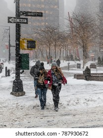 NEW YORK-JANUARY 4: Two bundled up girls crossing the street during the bomb cyclone on January 4 2018 in lower Manhattan.