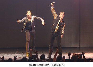 NEW YORK-JUL 9: Derek Hough (R) performs on stage during the Move Live On Tour at Radio City Music Hall on July 9, 2015 in New York City.