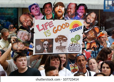 NEW YORK-JULY 13: A fan holds a sign referring to the Zac Brown Band on the Today Show at Rockefeller Plaza on July 13, 2012 in New York City.