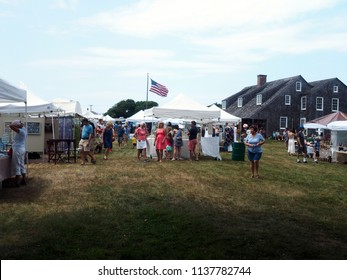 NEW YORK-JULY 14: Shoppers are seen looking at artist's and artisan's crafts at The Montauk Historical Society Craft Fair in Montauk, Long Island, The Hamptons, New York on July 14, 2018.