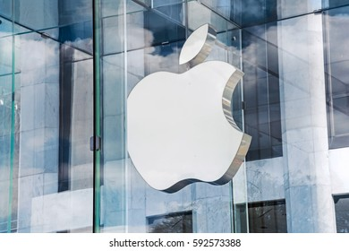 NEW YORK-JULY 24 - The Apple logo on the glass of the Apple Store, Fifth Avenue on July 24 2015 in Manhattan.