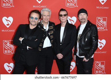 NEW YORK-JUN 26: (L-R) Bono, Adam Clayton, Larry Mullen Jr and The Edge of U2 attend the 13th Annual MusiCares MAP Fund Benefit Concert at PlayStation Theater on June 26, 2017 in New York City.