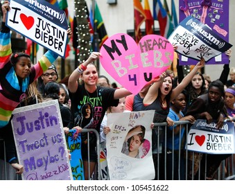 NEW YORK-JUNE 15: Justin Bieber fans hold signs before the concert on the Today Show at Rockefeller Plaza on June 15, 2012 in New York City.