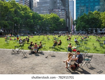 NEW YORK-JUNE 9: People relax on a beautiful late Spring day in Bryant Park on June 9, 2015 in midtown Manhattan.