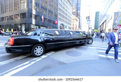 New York,Manhattan,USA. 05.08.2018. Black Lincoln Town Car Stretch Limousine is turning on the crossroad, servicing the local residents and visitors of the city, transporting to the special occasions.