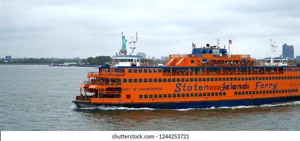 New York/Manhattan/USA - 6 October 2018: Staten Island Ferry passing the Statue of Liberty in New York Harbor.