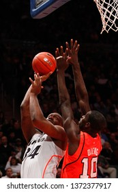 NEW YORK-MAR 10: Cincinnati Bearcats forward Yancy Gates (34)  and Louisville Cardinals center Gorgui Dieng (10) during the Big East Tournament on March 10, 2012 at Madison Square Garden in New York.