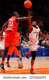NEW YORK-MAR 10: Cincinnati Bearcats guard Cashmere Wright (1) and Louisville Cardinals center Gorgui Dieng (10) during the Big East Tournament on March 10, 2012 at Madison Square Garden in New York.