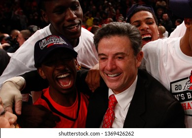 NEW YORK-MAR 10: Louisville Cardinals coach Rick Pitino with Russ Smith (2) and Gorgui Dieng (10) after winning the Big East Tournament vs the Cincinnati Bearcats on March 10, 2012 in New York.