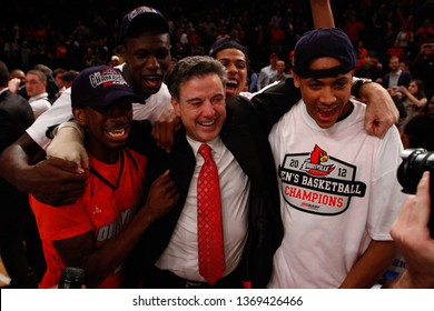 NEW YORK-MAR 10: Louisville Cardinals head coach Rick Pitino celebrates after winning the Big East Tournament vs the Cincinnati Bearcats on March 10, 2012 in New York.