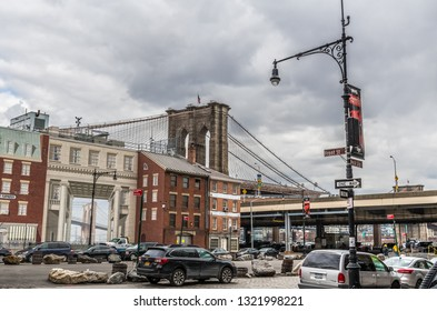 NEW YORK-MARCH 23: A street view with the Brooklyn Bridge and apartment buildings on March 23 2018 in lower Manhattan.