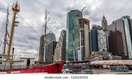 NEW YORK-MARCH 23: A tall ship in South Street Seaport and modern skyscrapers under construction on March 23 2018 in lower Manhattan.