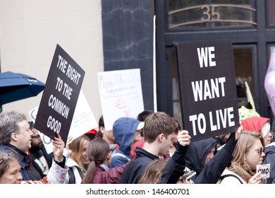 NEW YORK-MAY 25: A protestor holds a sign that says 'We Want To Live' above the crowd at the March Against Monsanto on May 25, 2013 in New York. The rally was part of a global movement against GMO's.