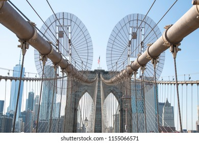 New York/New York/USA - Mai 30 2018:  Partial view of the Brooklyn Bridge, security system placed on the cables to prevent unauthorized entry