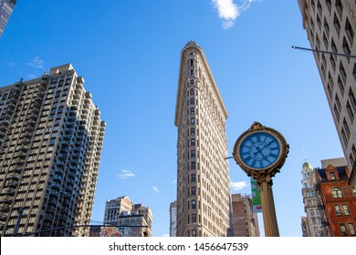 New York,NY/USA-April 15,2019. Iconic Flatiron Building in Manhattan and a clock.